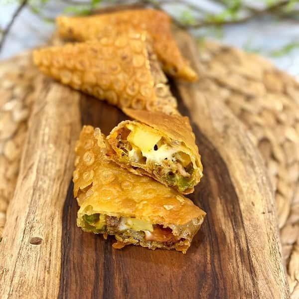 طرز تهیه سمبوسه پیتزایی بدون گوشت رولی با کالباس با مرغ در فر با خمیر پیراشکی با گوشت چرخ کرده پیچیدن سمبوسه پیتزایی